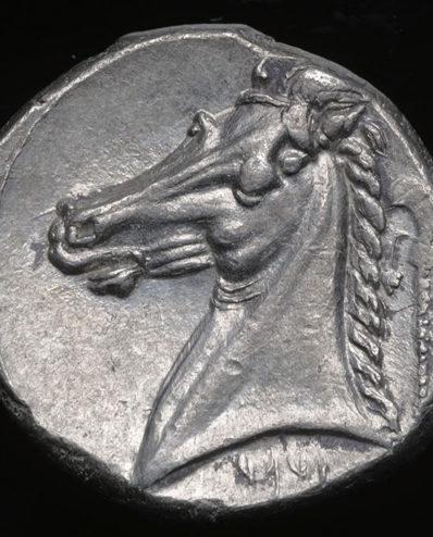 094951a43a Splendida testa della dea Tanit su moneta punica in argento (IV sec. a. C.)